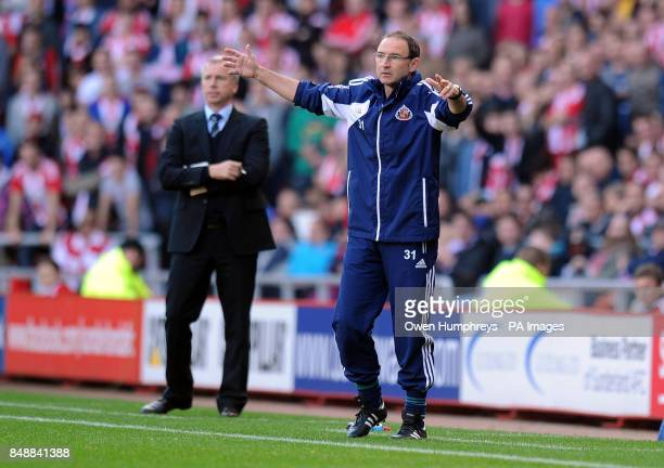 Sunderland manager Martin O'Neill gestures next to Newcastle manager Alan Pardew during the Barclays Premier League match at the Stadium of Light...
