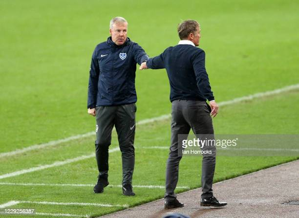 Sunderland manager Phil Parkinson touches fists with Kenny Jacket after the game during the Sky Bet League One match between Sunderland and...
