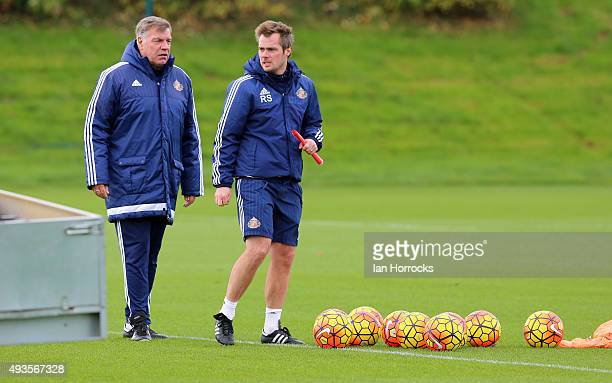 Sunderland manager Sam Allardyce chats with coach Robbie Stockdale during a Sunderland training session at the Academy of Light on October 21 2015 in...