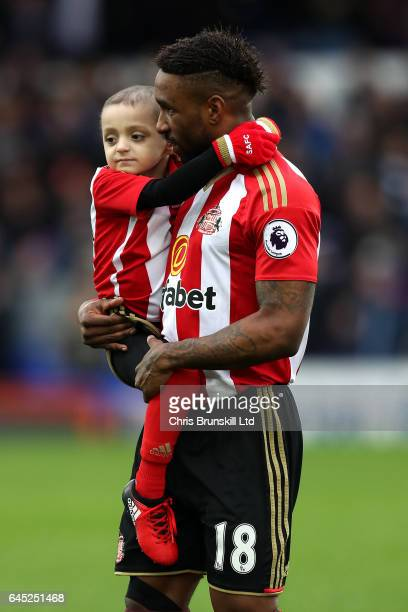 Sunderland mascot Bradley Lowery is carried by Jermaine Defoe ahead of during the Premier League match between Everton and Sunderland at Goodison...