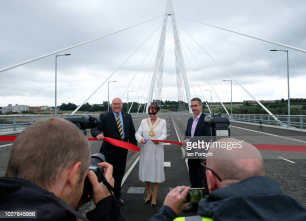 Sunderland Mayor Councillor Lynda Scanlan cuts the ribbon as the new Northern Spire bridge spanning the River Wear officially opens to traffic on...