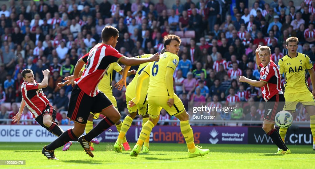 Sunderland player Adam Johnson (l) fires in the first Sunderland goal during the Barclays Premier League match between Sunderland and Tottenham Hotspur at Stadium of Light on September 13, 2014 in Sunderland, England.