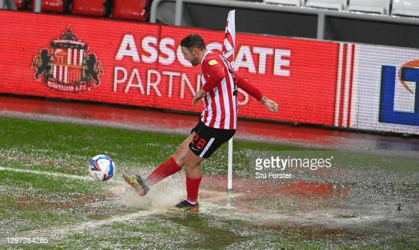Sunderland player Aiden McGeady takes a corner for Sunderland in the rain saturated corner of the pitch during the Sky Bet League One match between...