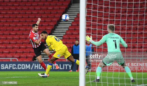 Sunderland player Bailey Wright fires in the first Sunderland goal despite the attentions of Wimbledon defender Terell Thomas during the Sky Bet...