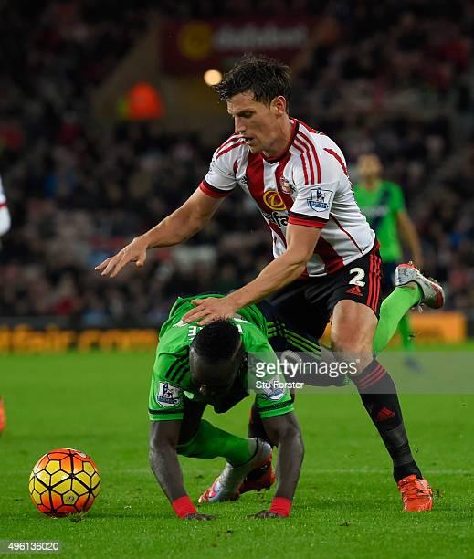 Sunderland player Billy Jones fouls Sadio Mane of Southampton during the Barclays Premier League match between Sunderland and Southampton at Stadium...