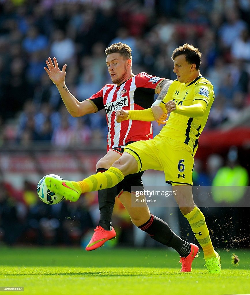 Sunderland player Connor Wickham (l) challenges Vlad Chirches of Spurs during the Barclays Premier League match between Sunderland and Tottenham Hotspur at Stadium of Light on September 13, 2014 in Sunderland, England.