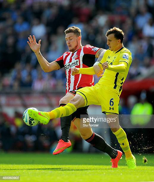 Sunderland player Connor Wickham challenges Vlad Chirches of Spurs during the Barclays Premier League match between Sunderland and Tottenham Hotspur...