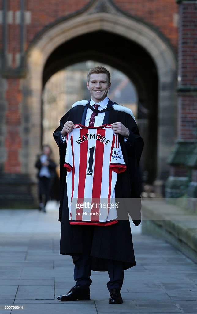 sunderland player duncan watmore pictured with a commemorative shirt after graduating from newcastle university with a