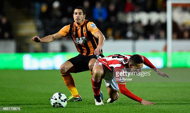 Sunderland player Jack Rodwell is fouled by Jake Livermore during the Barclays Premier League match between Hull City and Sunderland at KC Stadium on...