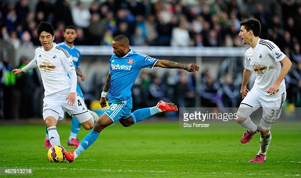 Sunderland player Jermain Defoe shoots to score the opening goal during the Barclays Premier League match between Swansea City and Sunderland at...