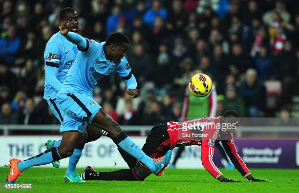 Sunderland player Jozy Altidore is challenged by Dedryck Boyata during the Barclays Premier League match between Sunderland and Manchester City at...