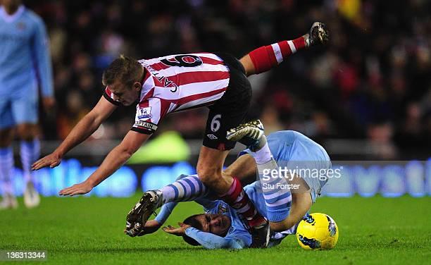 Sunderland player Lee Cattermole battles with City player Edin Dzeko during the Barclays Premier League match between Sunderland and Manchester City...