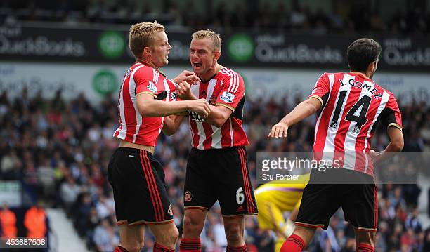 Sunderland player Lee Cattermole congratulates Seb Larsson after Larsson had score the second goal during the Barclays Premier League match between...