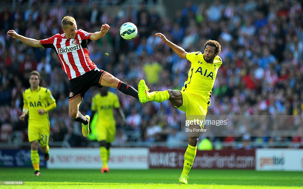 Sunderland player Sebastian Larsson (l) challenges Moussa Dembele of Spurs during the Barclays Premier League match between Sunderland and Tottenham Hotspur at Stadium of Light on September 13, 2014 in Sunderland, England.