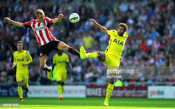 Sunderland player Sebastian Larsson challenges Moussa Dembele of Spurs during the Barclays Premier League match between Sunderland and Tottenham...
