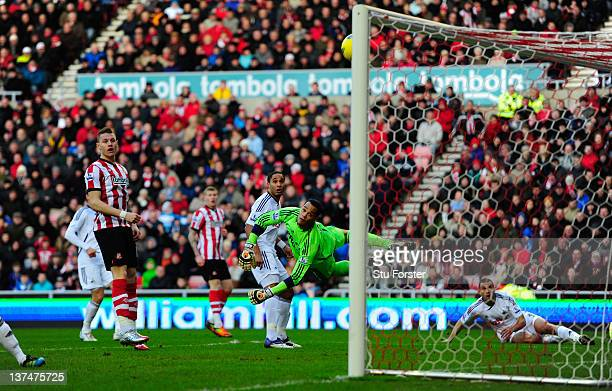 Sunderland player Stephane Sessegnon scores past the despairing dive of Swansea keeper Michel Vorm during the Barclays Premier League game between...