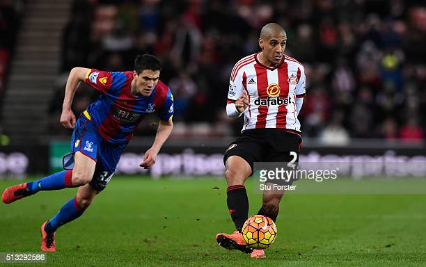 Sunderland player Wahbi Khazri holds off the challenge of Martin Kelly of Palace during the Barclays Premier League match between Sunderland and...
