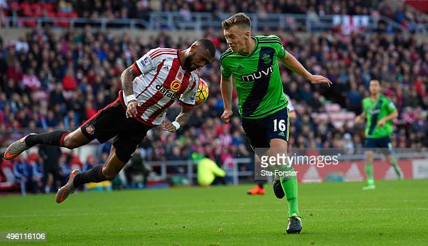 Sunderland player Yann M'vila challenges James WardProwse of Southampton during the Barclays Premier League match between Sunderland and Southampton...