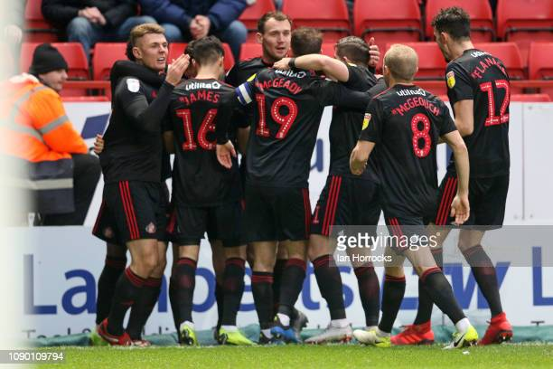 Sunderland players celebrate scoring the opening goal during the Sky Bet League One match between Charlton Athletic and Sunderland at The Valley on...