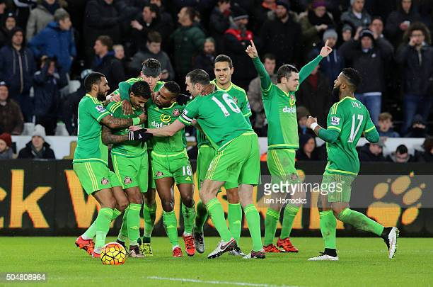 Sunderland players celebrate the fourth Sunderland goal around Jermain Defoe during the Barclays Premier League Match between Swansea City and...