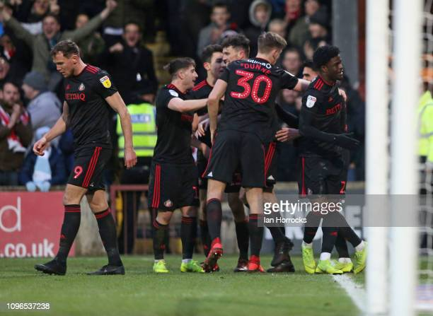 Sunderland players celebrate the opening goal scored by Josh Maja during the Sky Bet League One match between Scunthorpe United and Sunderland at...