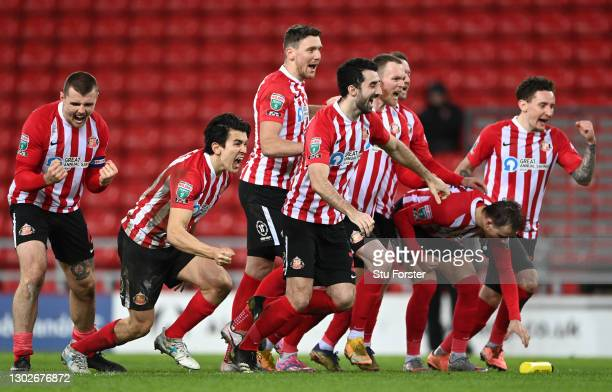 Sunderland players celebrate the penalty shoot out out victory after the Papa John's Trophy Semi-Final match between Sunderland and Lincoln City on...