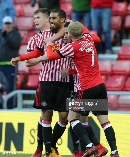 Sunderland players celebrate with Lewis Grabban after he scores the first goal during the Sky Bet Championship match between Sunderland and Millwall...