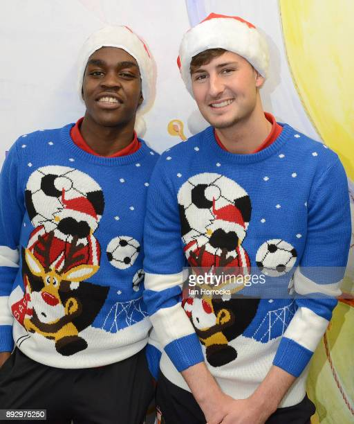 Sunderland players Joel Asoro and Ethan Robson line up in their Christmas jumpers during a Christmas visit to Sunderland Royal Infirmary on December...