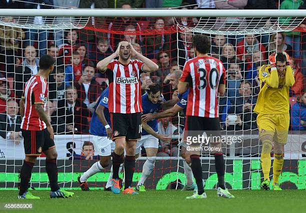 Sunderland players react as Leighton Baines of Everton scores their first goal from a penalty during the Barclays Premier League match between...