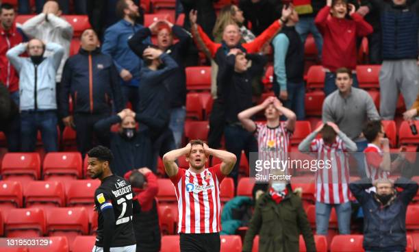 Sunderland striker Charlie Wyke and Sunderland fans react after Wyke had missed a first half chance during the Sky Bet League One Play-off Semi Final...