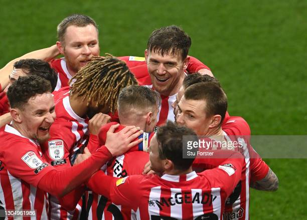 Sunderland striker Charlie Wyke and team mates celebrate after he had scored the first goal during the Sky Bet League One match between Sunderland...