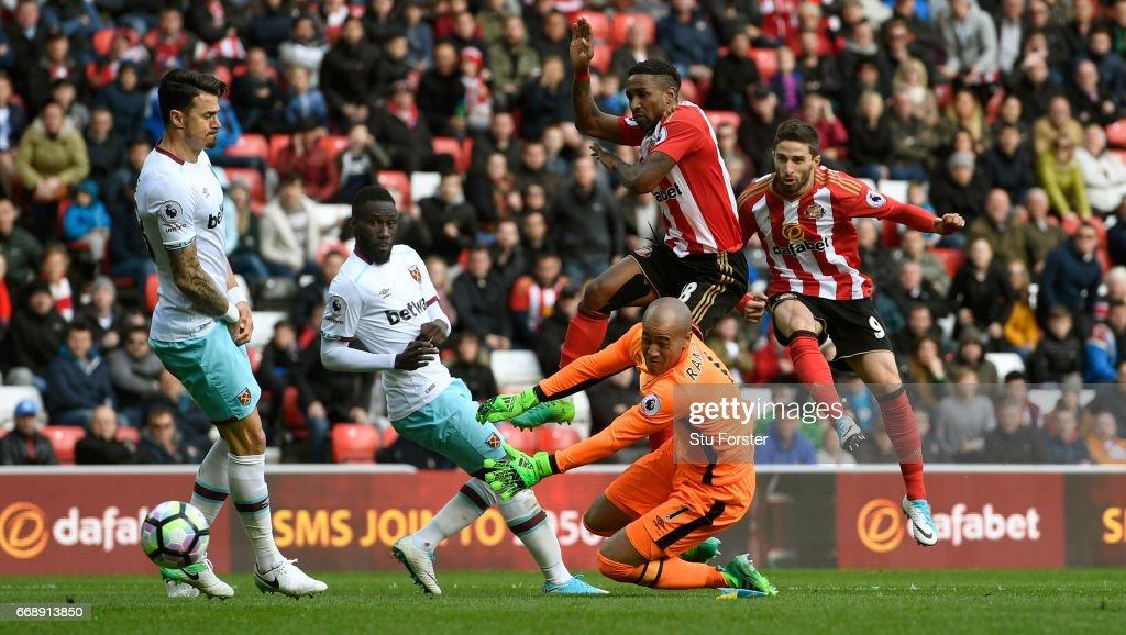 Sunderland striker Fabio Borini (r) shoots past West Ham goalkeeper Darren Rudolph to score the second Sunderland goal during the Premier League match between Sunderland and West Ham United at Stadium of Light on April 15, 2017 in Sunderland, England.