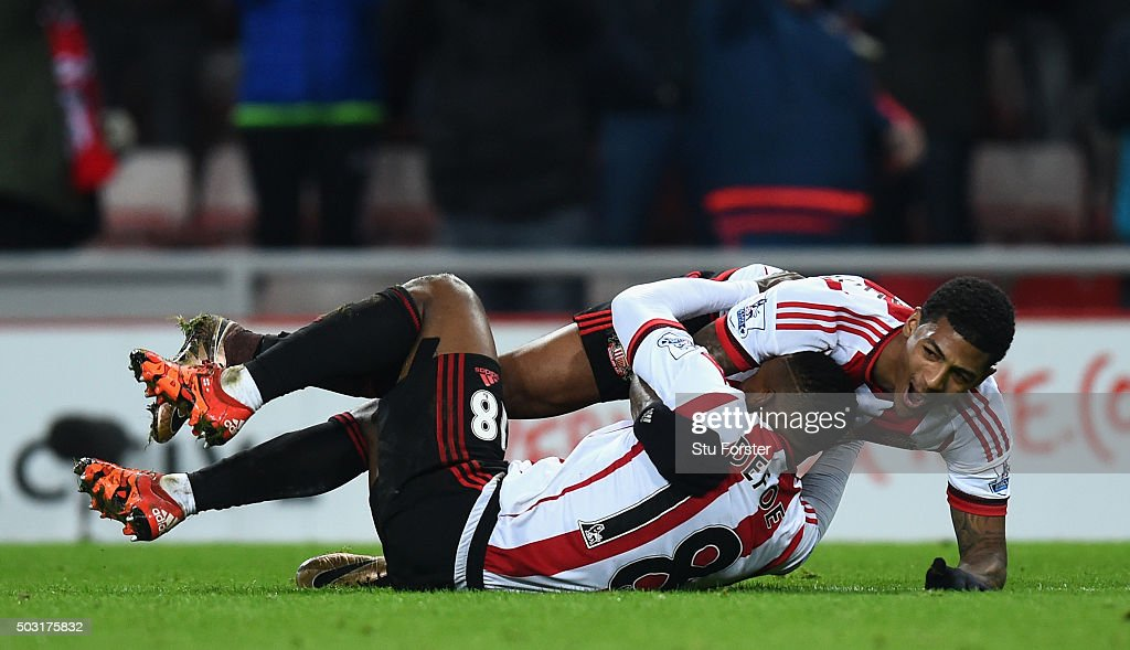 Sunderland striker Jermaine Defoe (l) is congratulated by Patrick Van Aanhot after scoring the third Sunderland goal during the Barclays Premier League match between Sunderland and Aston Villa at Stadium of Light on January 2, 2016 in Sunderland, England.