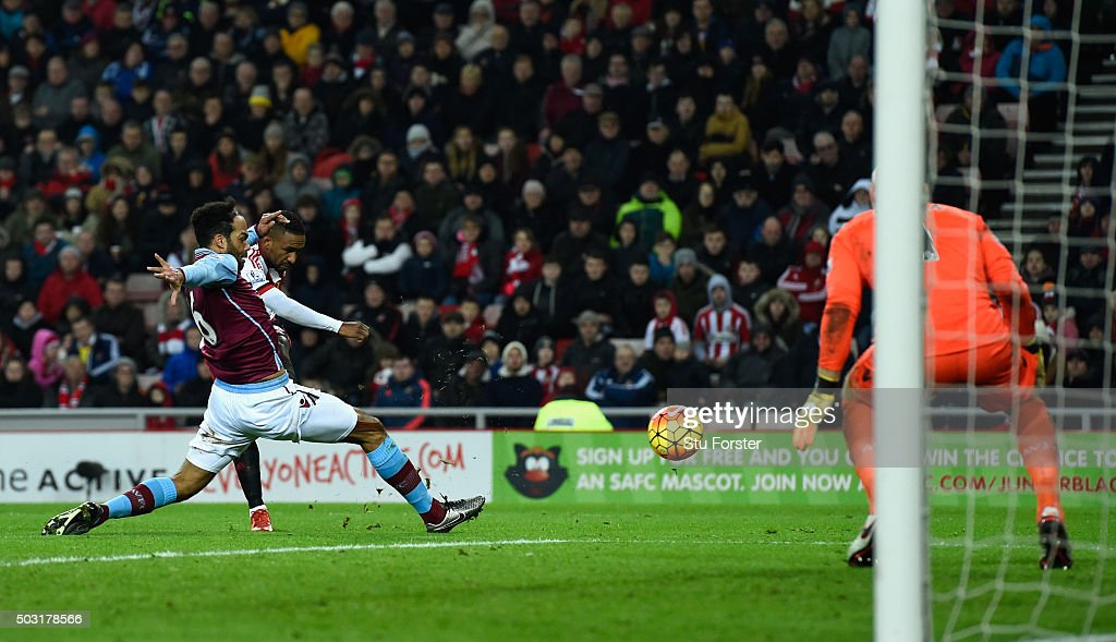 Sunderland striker Jermaine Defoe shoots to score the second Sunderland goal during the Barclays Premier League match between Sunderland and Aston Villa at Stadium of Light on January 2, 2016 in Sunderland, England.