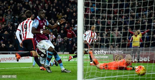 Sunderland striker Jermaine Defoe wheels away after scoring the second Sunderland goal during the Barclays Premier League match between Sunderland...