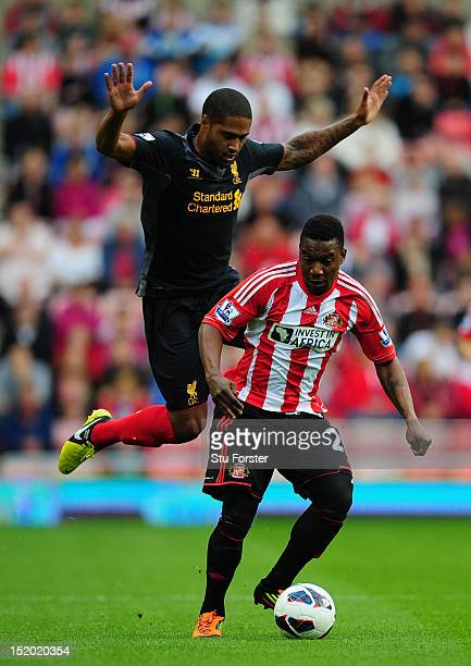 Sunderland striker Stephane Sessegnon beats Glen Johnson to the ball during the Barclays Premier league match between Sunderland and Liverpool at...