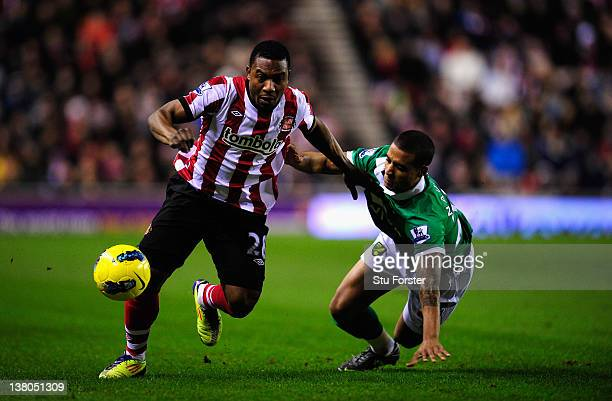 Sunderland striker Stephane Sessegnon skips past Norwich defender Kyle Naughton during the Barclays Premier League game between Sunderland and...