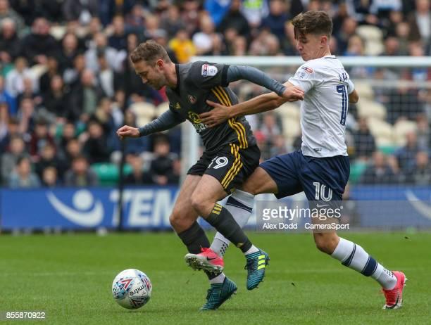 Sunderland's Aidan McGeady holds off the challenge from Preston North End's Josh Harrop during the Sky Bet Championship match between Preston North...