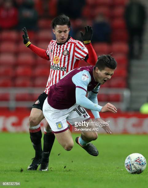 Sunderland's Bryan Oviedo left battles for the ball with Aston Villa's Jack Grealish right during the Sky Bet Championship match between Sunderland...