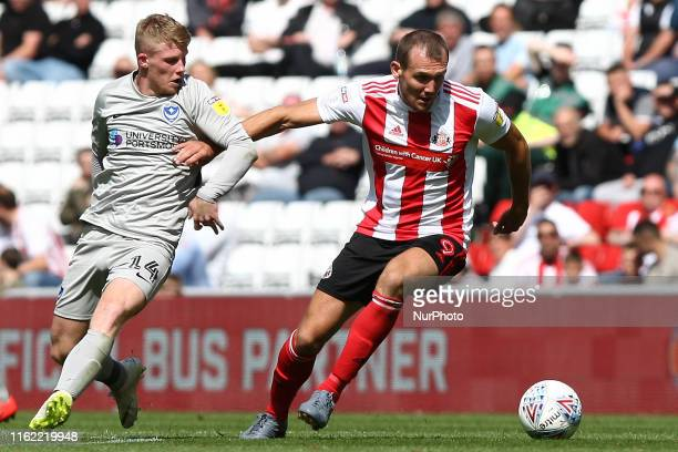 Sunderland's Charlie Wyke competes for the ball with Portsmouth's Andy Cannon during the Sky Bet League 1 match between Sunderland and Portsmouth at...