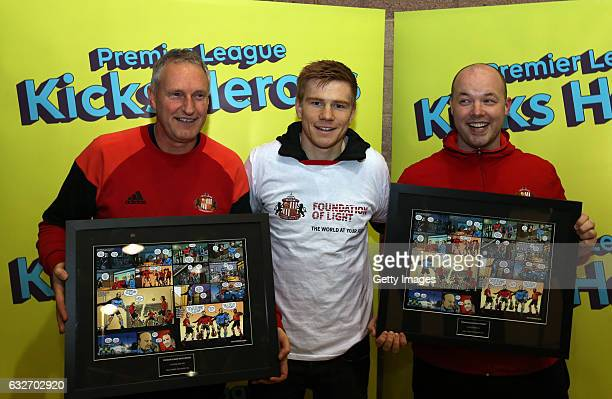 Sunderland's Duncan Watmore center poses for the media with Ian Corner left and Mark Pae right on January 25 2017 in Sunderland England