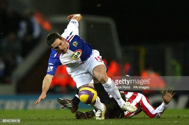 Sunderland's Dwight Yorke fouls Blackburn Rovers' David Dunn leadinf to the midfielder being sent off