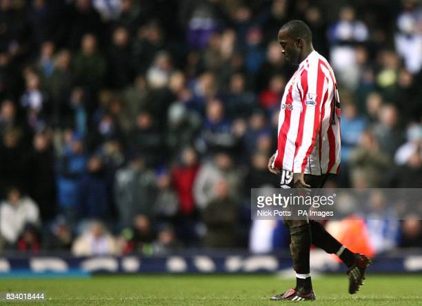 Sunderland's Dwight Yorke leaves the pitch after being shown a red card by referee Rob Styles