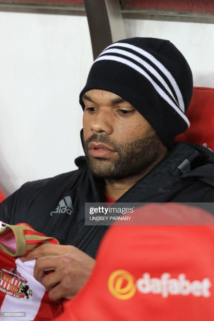 Sunderland's English defender Joleon Lescott takes his place on the bench for the English Premier League football match between Sunderland and Tottenham Hotspur at the Stadium of Light in Sunderland, north-east England on January 31, 2017. / AFP / Lindsey PARNABY / RESTRICTED TO EDITORIAL USE. No use with unauthorized audio, video, data, fixture lists, club/league logos or 'live' services. Online in-match use limited to 75 images, no video emulation. No use in betting, games or single club/league/player publications. /