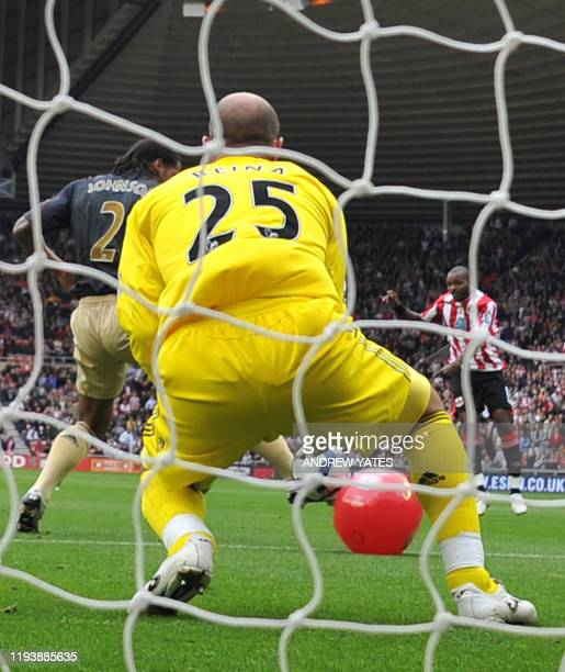 Sunderland's English forward Darren Bent shoots and his shot hits a red beach-ball and deflects past Liverpool's Spanish goalkeeper Pepe Reina into...