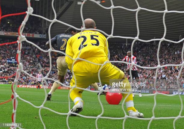 Sunderland's English forward Darren Bent shoots and his shot hits a red beach-ball and deflects into the net for the only goal of the English Premier...