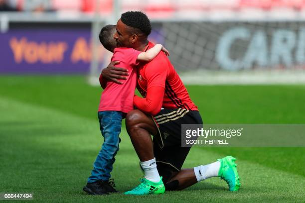 Sunderland's English striker Jermain Defoe hugs Bradley Lowery a fiveyearold suffering from terminal cancer ahead of the English Premier League...