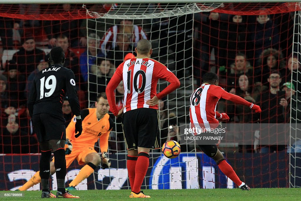 Sunderland's English striker Jermain Defoe (R) scores their second goal from the penalty spot during the English Premier League football match between Sunderland and Liverpool at the Stadium of Light in Sunderland, north-east England on January 2, 2017. / AFP / Lindsey PARNABY / RESTRICTED TO EDITORIAL USE. No use with unauthorized audio, video, data, fixture lists, club/league logos or 'live' services. Online in-match use limited to 75 images, no video emulation. No use in betting, games or single club/league/player publications. /