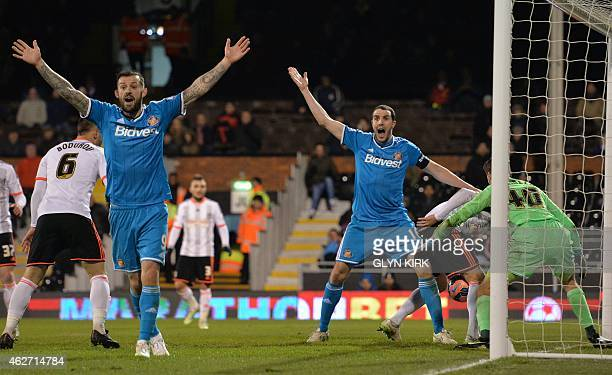 Sunderland's Englishborn Scottish striker Steven Fletcher and Sunderland's Irish defender John O'Shea appeal for an owngoal after Fulham's English...