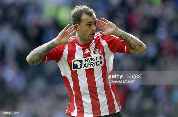 Sunderland's Englishborn Scottish striker Steven Fletcher celebrates scoring the opening goal of the English Premier League football match between...